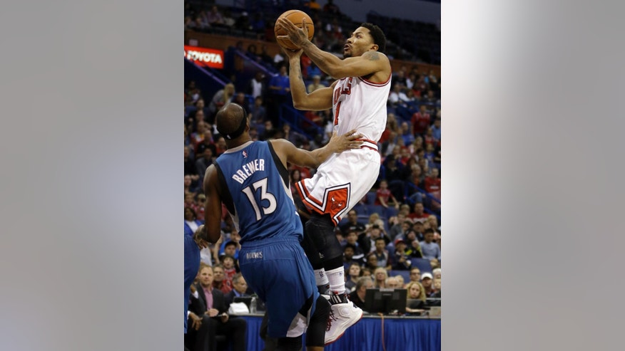 Chicago Bulls' Derrick Rose, right, heads to the basket as Minnesota Timberwolves' Corey Brewer defends during the first half of a preseason NBA basketball game Friday, Oct. 24, 2014, in St. Louis. (AP Photo/Jeff Roberson)