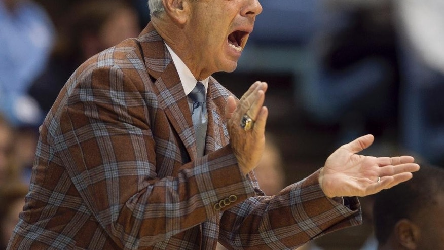 North Carolina coach Roy Williams applauds his team during the first half against Fayetteville State during an NCAA college basketball exhibition game Friday, Oct. 24, 2014, Chapel Hill, N.C.  (AP Photo/The News & Observer, Robert Willett)