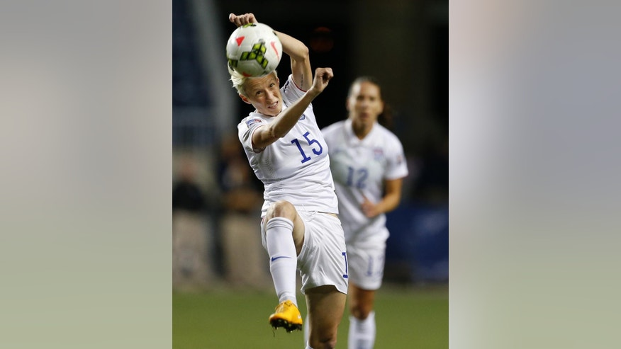 United States midfielder Megan Rapinoe (15) heads the ball in the first half against Mexico during a CONCACAF semifinal soccer match in Philadelphia, Pa., Friday, Oct. 24, 2014. (AP Photo/Rich Schultz)