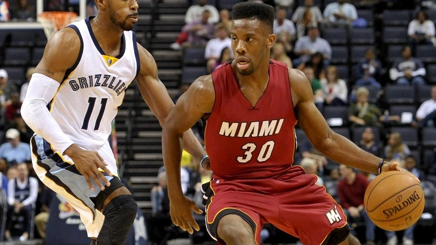 Miami Heat guard Norris Cole (30) drives against Memphis Grizzlies guard Mike Conley (11) in the first half of a preseason NBA basketball game Friday, Oct. 24, 2014, in Memphis, Tenn.  (AP Photo/Brandon Dill)