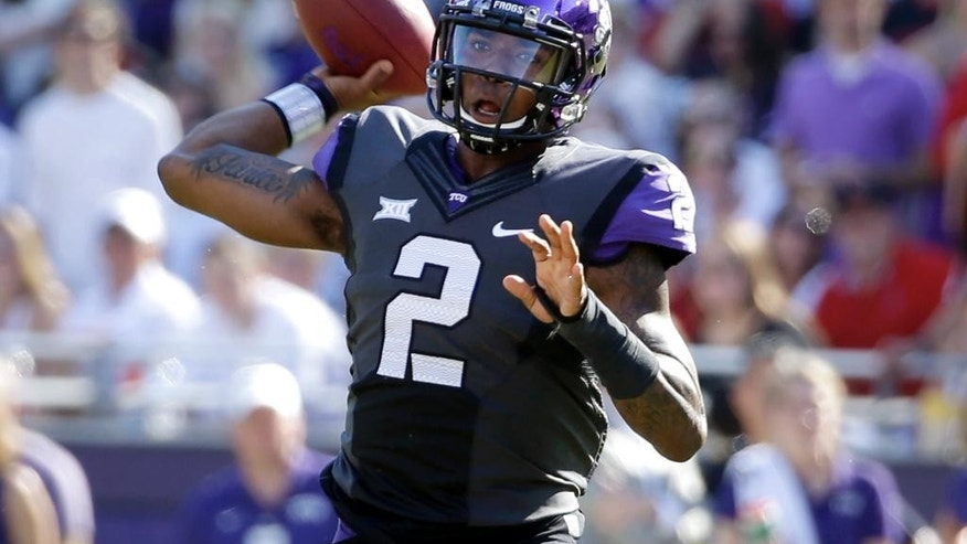 TCU quarterback Trevone Boykin (2) throws a pass in the first half of an NCAA college football game against Texas Tech, Saturday, Oct. 25, 2014, in Fort Worth, Texas. (AP Photo/Tony Gutierrez)