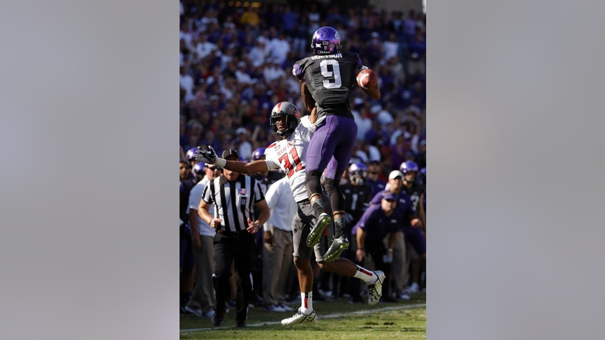 Texas Tech defensive back Justis Nelson (31) breaks up a pass intended for TCU wide receiver Josh Doctson (9) in the first half of an NCAA college football game, Saturday, Oct. 25, 2014, in Fort Worth, Texas. Nelson was charged with pass interference on the play. (AP Photo/Tony Gutierrez)
