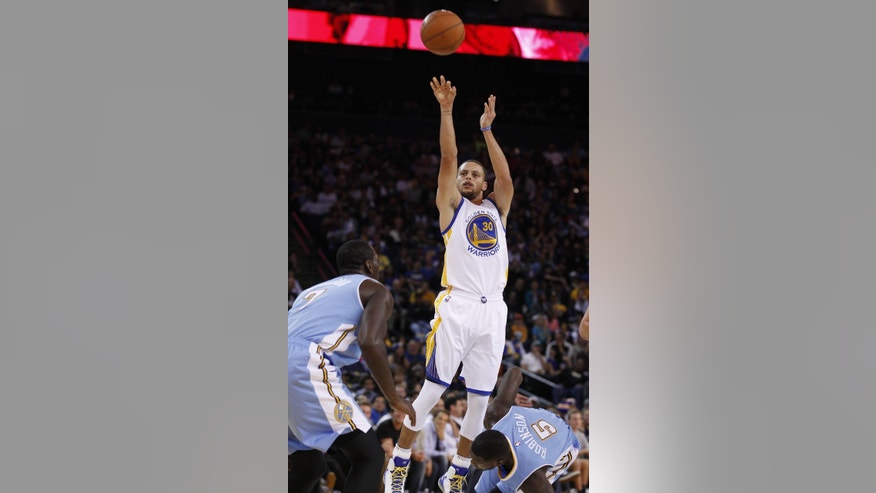 Golden State Warriors' Stephen Curry shoots over  Denver Nuggets' J.J. Hickson, left, and Nate Robinson (5) during the second half of a preseason NBA basketball game, Friday, Oct. 24, 2014, in Oakland, Calif. (AP Photo/George Nikitin)
