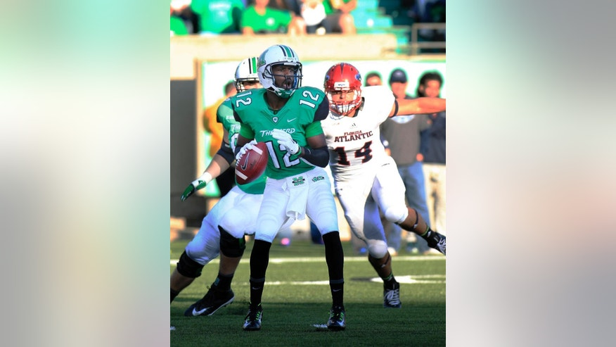 Marshall quarterback Rakeem Cato looks for an open receiver against Florida Atlantic, Saturday, Oct. 25, 2014 during an NCAA college football game in Huntington, W.Va. (AP Photo/Randy Snyder)