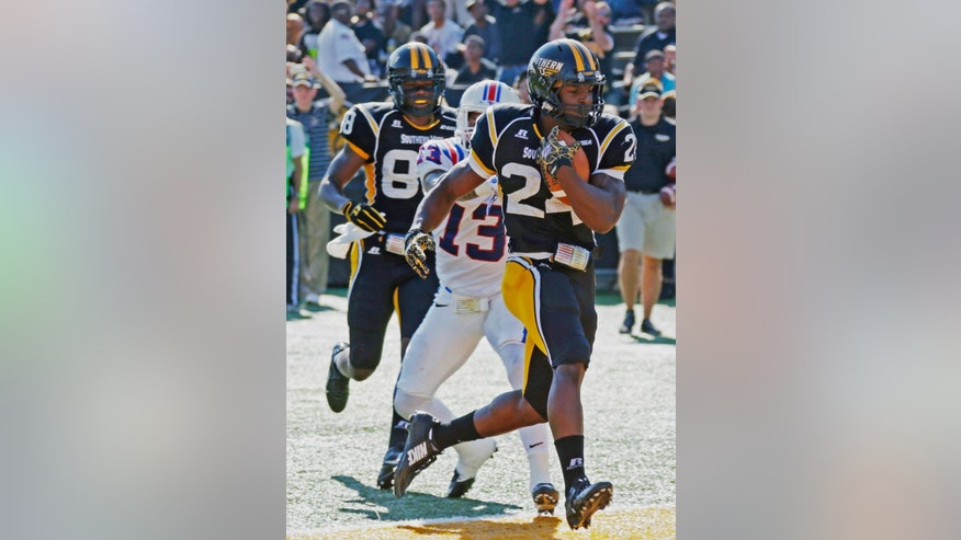 Southern Mississippi running back George Payne (24) runs past Louisiana Tech defensive back Le'Vander Liggins (13) for an 18-yard touchdown in the first half of an NCAA college football game in Hattiesburg, Miss., Saturday, Oct. 25, 2014. (AP Photo/Rogelio V. Solis)
