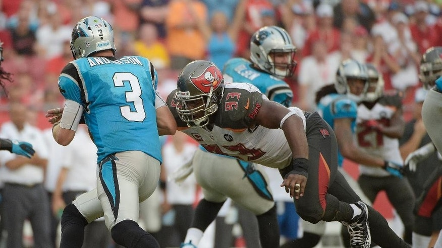 FILE - in this Sept. 7, 2014, file photo, Tampa Bay Buccaneers defensive tackle Gerald McCoy (93) sacks Carolina Panthers quarterback Derek Anderson (3) during the third quarter of an NFL football game in Tampa, Fla. McCoy has signed a seven-year extension with the Buccaneers worth $98 million, making him the highest-paid player at his position.   (AP Photo/Phelan M. Ebenhack, File)