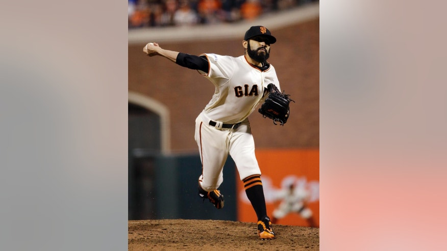 San Francisco Giants pitcher Sergio Romo throws during the seventh inning of Game 3 of baseball's World Series against the Kansas City Royals Friday, Oct. 24, 2014, in San Francisco. (AP Photo/Matt Slocum)
