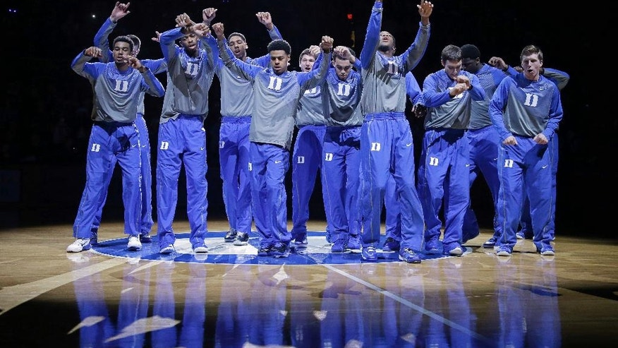 Duke's basketball team is introduced during Countdown to Craziness as the team kicks off its NCAA college basketball season at Cameron Indoor Stadium in Durham, N.C., Saturday, Oct. 25, 2014. (AP Photo/Gerry Broome)