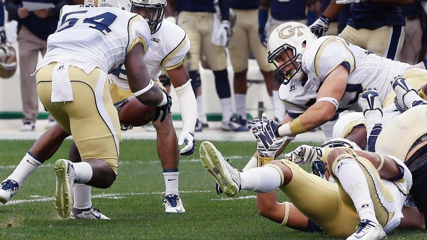 Georgia Tech linebacker Quayshawn Nealy (54) recovers a fumble by Pittsburgh quarterback Chad Voytik in the first quarter of an NCAA football game, Saturday, Oct. 25, 2014, in Pittsburgh. It was the first of five fumbles Pittsburgh lost in the first quarter. (AP Photo/Keith Srakocic)
