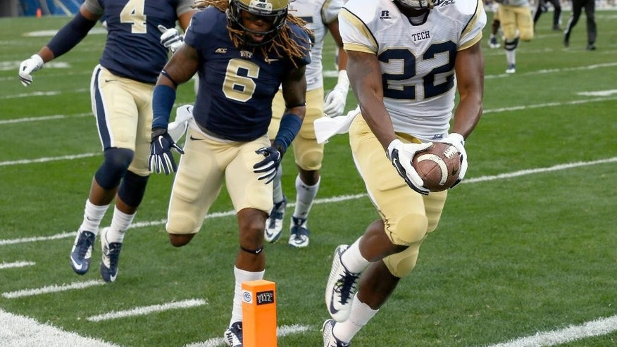 Georgia Tech running back Broderick Snoddy (22) outruns Pittsburgh linebacker Todd Thomas (8) for a touchdown in the first quarter of an NCAA football game, Saturday, Oct. 25, 2014, in Pittsburgh. (AP Photo/Keith Srakocic)