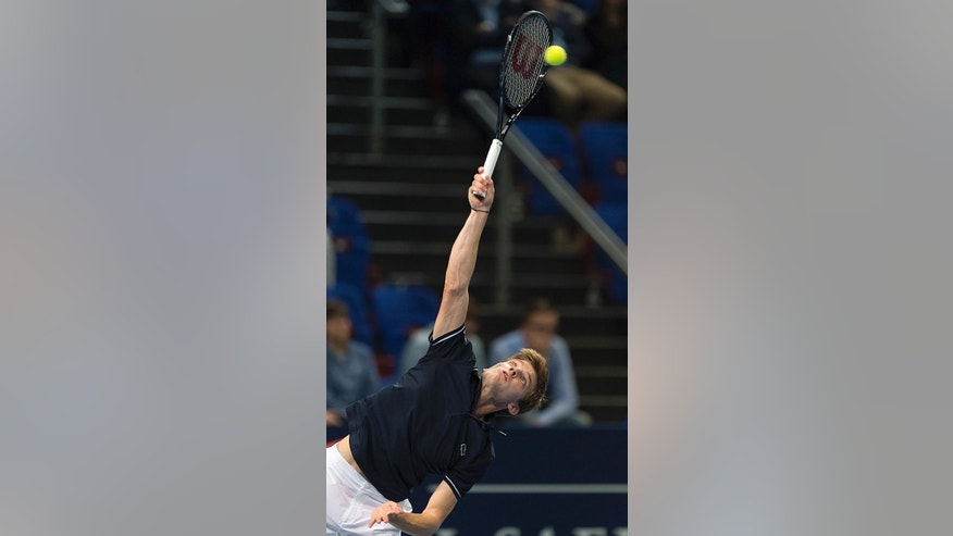 Belgium's David Goffin serves a ball to Croatia's Borna Coric during theirs semifinal match at the Swiss Indoors tennis tournament  in Basel, Switzerland, on Saturday, Oct.25, 2014. (AP Photo/Keystone,Georgios Kefalas)