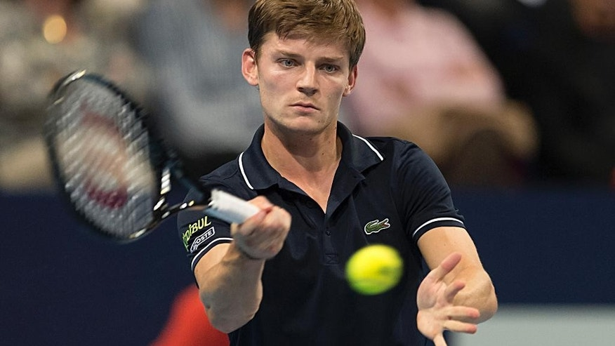 Belgium's David Goffin  returns a ball to Croatia's Borna Coric during theirs semifinal match at the Swiss Indoors tennis tournament  in Basel, Switzerland, on Saturday, Oct.25, 2014. (AP Photo/Keystone,Georgios Kefalas)