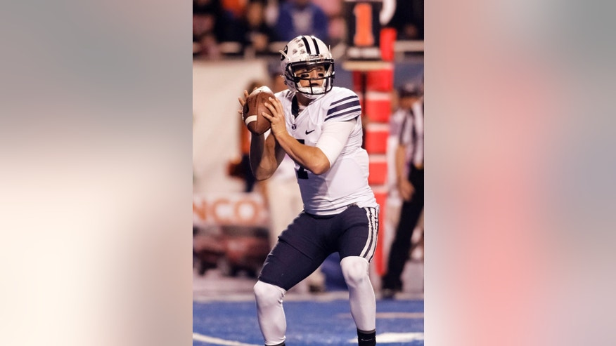 BYU quarterback Christian Stewart (7) looks for a receiver during the second quarter of an NCAA college football game against Boise State in Boise, Idaho, on Friday, Oct. 24, 2014. (AP Photo/Otto Kitsinger)