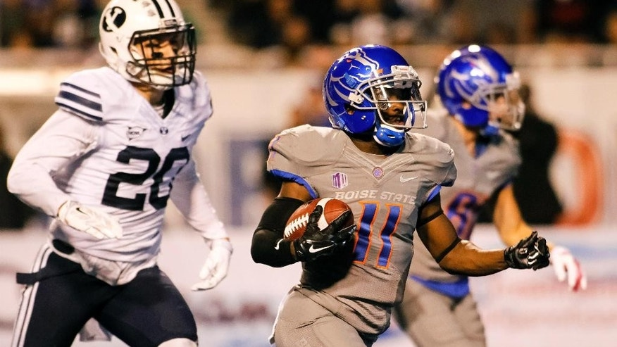 Boise State wide receiver Shane Williams-Rhodes (11) runs for a touchdown during the second quarter of an NCAA college football game against BYU in Boise, Idaho, Friday, Oct. 24, 2014. (AP Photo/Otto Kitsinger)