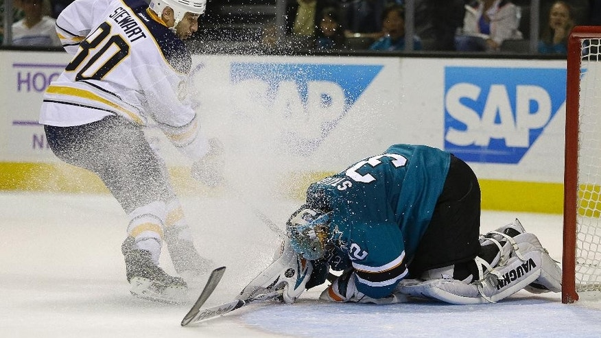 San Jose Sharks goalie Alex Stalock, right, blocks a shot by Buffalo Sabres' Chris Stewart (80) during the first period of an NHL hockey game Saturday, Oct. 25, 2014, in San Jose, Calif. (AP Photo/Ben Margot)