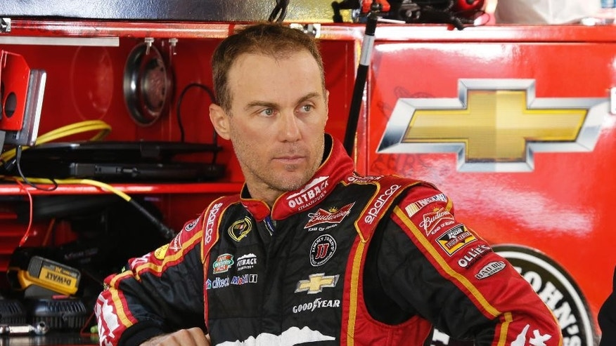 Kevin Harvick watches his crew in the garage as he waits for practice to begin for Sunday's Sprint Cup Series auto race at Martinsville Speedway in Martinsville, Va., Saturday, Oct. 25, 2014. (AP Photo/Steve Helber)