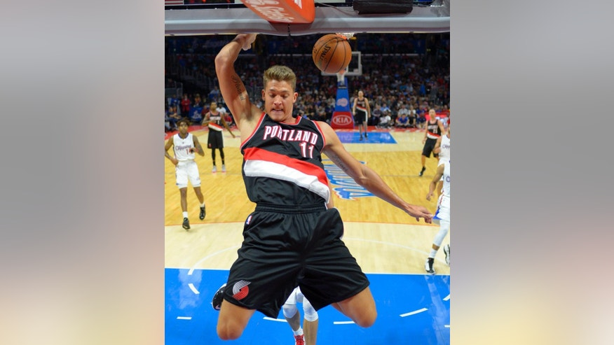 Portland Trail Blazers center Meyers Leonard dunks during the first half of a preseason NBA basketball game against the Los Angeles Clippers, Friday, Oct. 24, 2014, in Los Angeles.   (AP Photo/Mark J. Terrill)