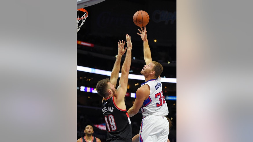 Los Angeles Clippers forward Blake Griffin, right, puts up a shot as Portland Trail Blazers center Joel Freeland, of England, defends during the first half of a preseason NBA basketball game, Friday, Oct. 24, 2014, in Los Angeles.   (AP Photo/Mark J. Terrill)