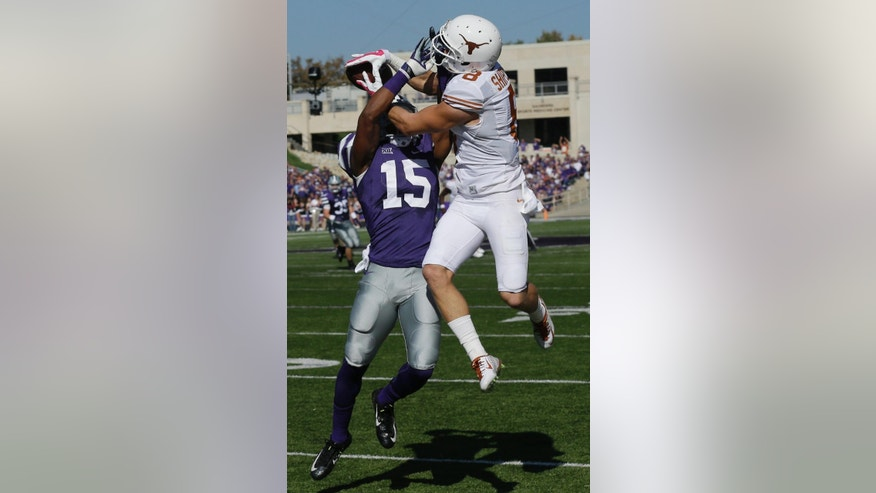 Texas wide receiver Jaxon Shipley (8) and Kansas State defensive back Randall Evans (15) battle for the ball during the first half of an NCAA college football game in Manhattan, Kan., Saturday, Oct. 25, 2014. The pass was incomplete. (AP Photo/Orlin Wagner)