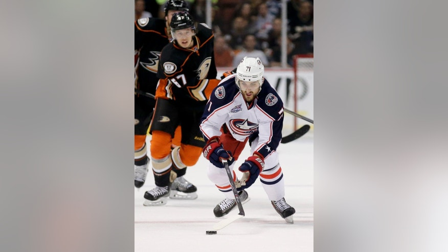 Columbus Blue Jackets left wing Nick Foligno skates past Anaheim Ducks center Rickard Rakell during the first period of an NHL hockey game in Anaheim, Calif., Friday, Oct. 24, 2014. (AP Photo/Chris Carlson)
