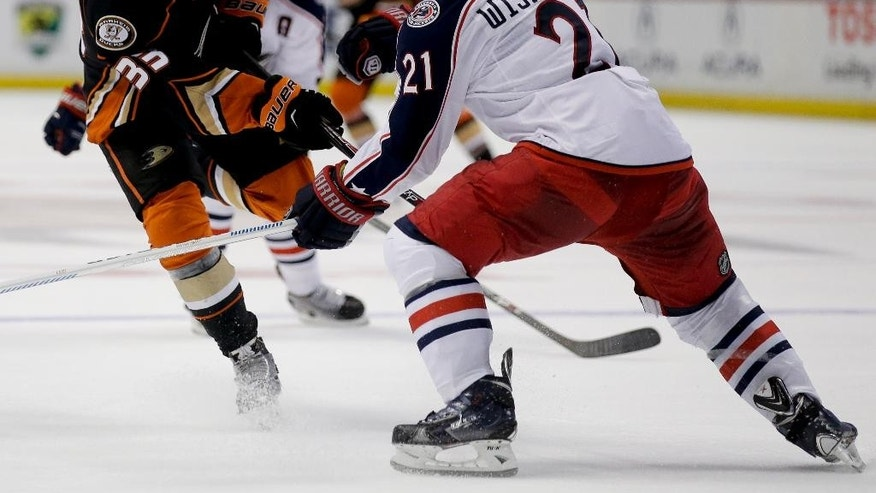 Anaheim Ducks right wing Jakob Silfverberg, left, shoots past Columbus Blue Jackets defenseman James Wisniewski during the second period of an NHL hockey game in Anaheim, Calif., Friday, Oct. 24, 2014. (AP Photo/Chris Carlson)