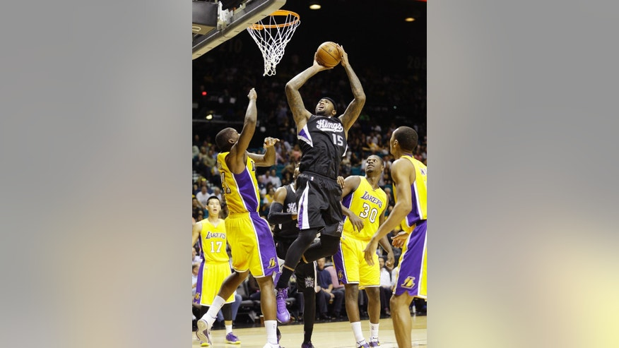 Sacramento Kings center DeMarcus Cousins (15) goes up for a shot against the Los Angeles Lakers during an NBA preseason basketball game Friday, Oct. 24, 2014, in Las Vegas. The Kings won 93-92. (AP Photo/John Locher)