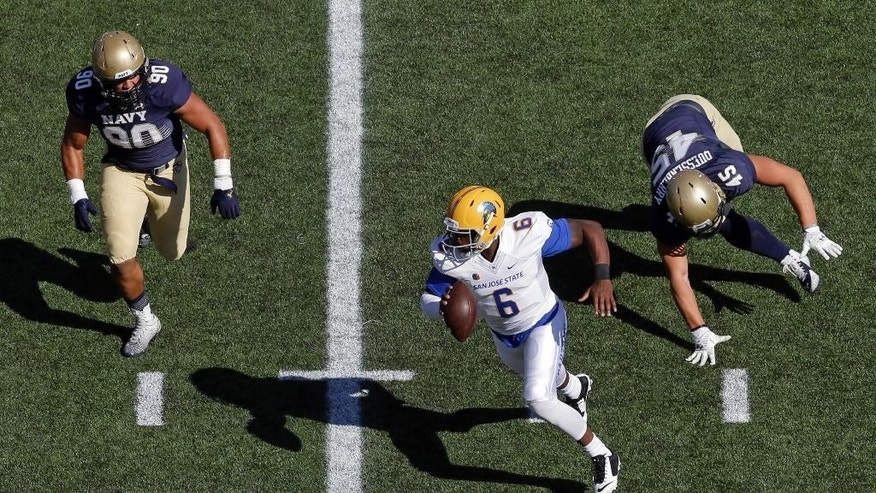 San Jose State quarterback Joe Gray (6) scrambles as he is pressured by Navy defensive ends Will Anthony, left, and Paul Quessenberry in the first half of an NCAA college football game in Annapolis, Md., Saturday, Oct. 25, 2014. (AP Photo/Patrick Semansky)