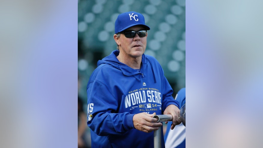 Kansas City Royals manager Ned Yost watches his team take batting practice during a baseball workout on Thursday, Oct. 23, 2014, in San Francisco. The Royals and the San Francisco Giants are to play Game 3 of baseball's World Series in San Francisco on Friday. (AP Photo/Eric Risberg)