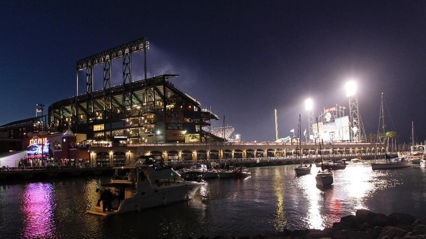 FILE- In this Oct. 6, 2012, file photo shows the view of the AT&T Park from McCovey Cove in San Francisco. A splash hit counter in right field at the park keeps track of how many home runs have landed into McCovey Cove. (AP Photo/Jeff Chiu, File)