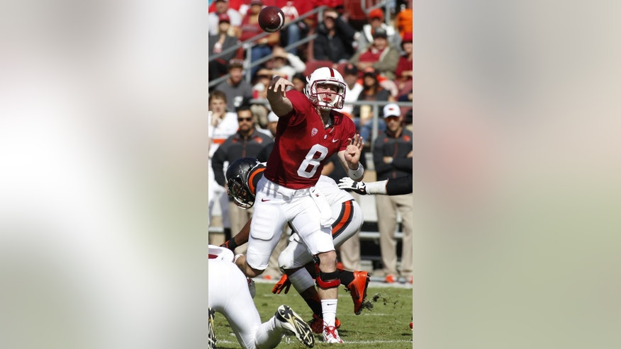 Stanford quarterback Kevin Hogan throws during the first half of an NCAA college football game and Oregon State, Saturday, Oct. 25, 2014, in Stanford, Calif. (AP Photo/George Nikitin)