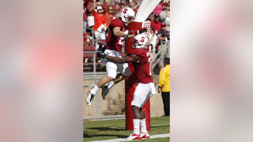 Stanford's Christian McCaffrey, left, celebrates with Ty Montgomery after scoring a touchdown against Oregon State during the first half of an NCAA college football game, Saturday, Oct. 25, 2014, in Stanford, Calif. (AP Photo/George Nikitin)