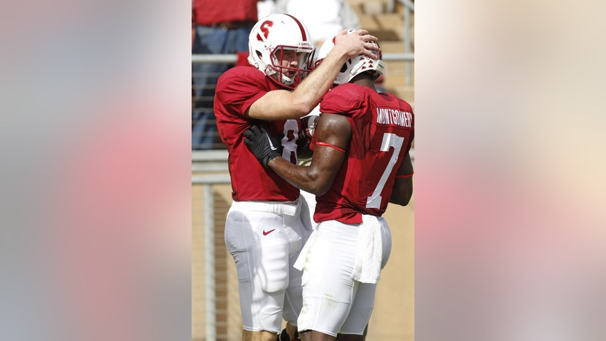 Stanford quarterback Kevin Hogan, left, celebrates with Ty Montgomery after scoring a touchdown against Oregon State during the first half of an NCAA college football game, Saturday, Oct. 25, 2014, in Stanford, Calif. (AP Photo/George Nikitin)