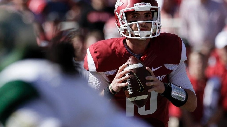 Arkansas quarterback Brandon Allen looks for a receiver in the first quarter of an NCAA college football game against UAB in Fayetteville, Ark., Saturday, Oct. 25, 2014. (AP Photo/Danny Johnston)