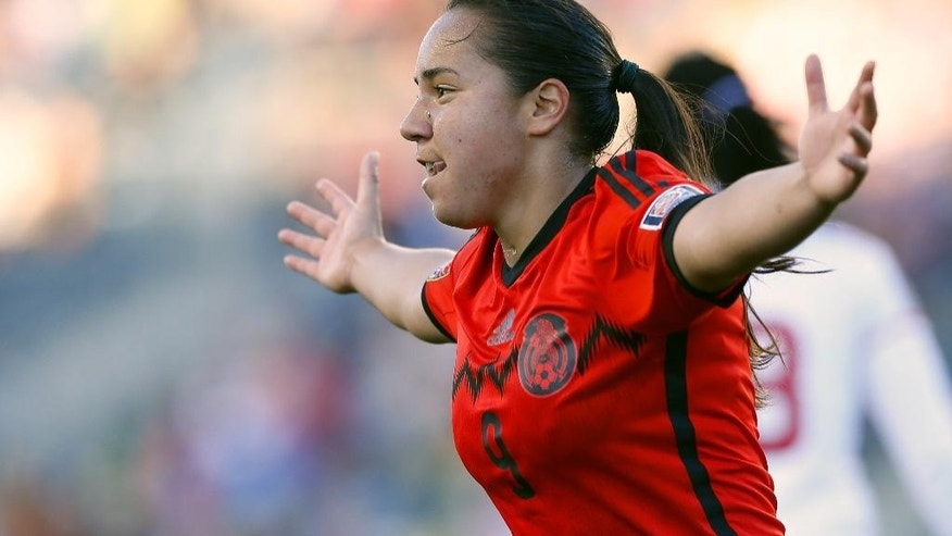 Mexico forward Veronica Charlyn Corral (9) reacts after scoring a goal in overtime against Trinidad and Tobago during a CONCACAF soccer match in Chester, Pa., Sunday, Oct. 26, 2014. Mexico defeated Trinidad and Tobago 4-2 in overtime. (AP Photo/Rich Schultz)