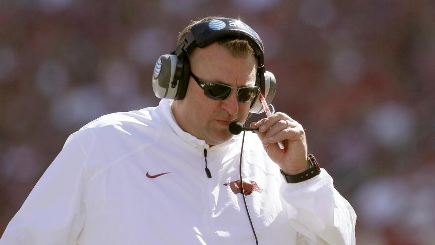 Arkansas coach Bret Bielema talks on his headset in the fourth quarter of an NCAA college football game against UAB in Fayetteville, Ark., Saturday, Oct. 25, 2014. Arkansas won 45-17. (AP Photo/Danny Johnston)