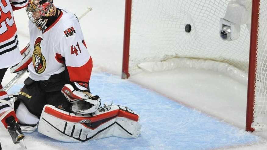Ottawa Senators goalie Craig Anderson (41), misses a goal scored by Chicago Blackhawks' Brent Seabrook during the second period of a NHL hockey game in Chicago, Sunday, Oct. 26, 2014. (AP Photo/Paul Beaty)