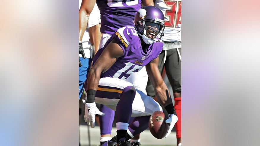 Minnesota Vikings wide receiver Greg Jennings (15) reacts after scoring a touchdown against the Tampa Bay Buccaneers during the third quarter of an NFL football game Sunday, Oct. 26, 2014, in Tampa, Fla. (AP Photo/Reinhold Matay)