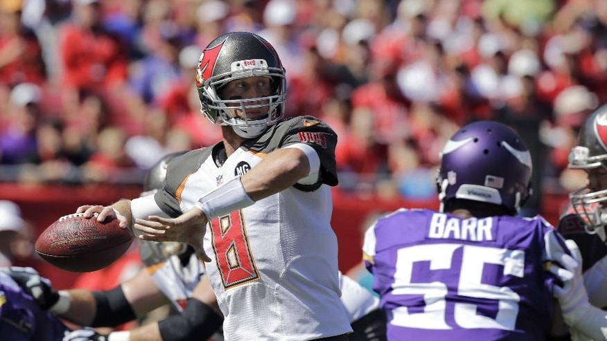 Tampa Bay Buccaneers quarterback Mike Glennon (8) is pressured by Minnesota Vikings outside linebacker Anthony Barr (55) as he throws a pass during the first quarter of an NFL football game Sunday, Oct. 26, 2014, in Tampa, Fla. (AP Photo/Chris O'Meara)