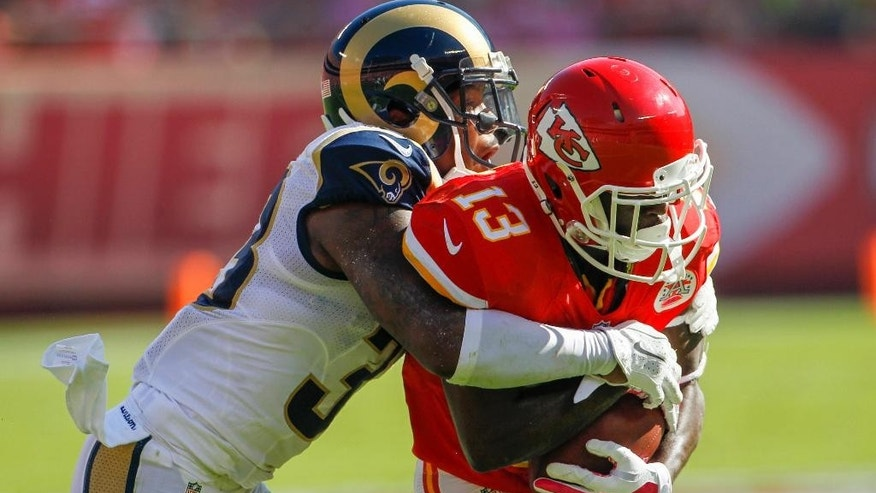 Kansas City Chiefs running back De'Anthony Thomas (13) is tackled by St. Louis Rams cornerback E.J. Gaines (33) in the first half of an NFL football game in Kansas City, Mo., Sunday, Oct. 26, 2014. (AP Photo/Colin E. Braley)