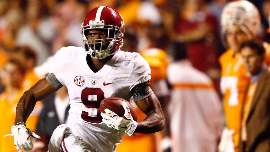 Alabama wide receiver Amari Cooper (9) runs for a touchdown in the first quarter of an NCAA college football game against Tennessee, Saturday, Oct. 25, 2014, in Knoxville, Tenn. (AP Photo/Wade Payne)