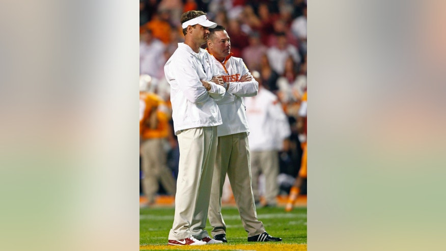 Tennessee coach Butch Jones, right, talks with Alabama offensive coordinator Lane Kiffin before an NCAA college football game Saturday, Oct. 25, 2014, in Knoxville, Tenn. (AP Photo/Wade Payne)