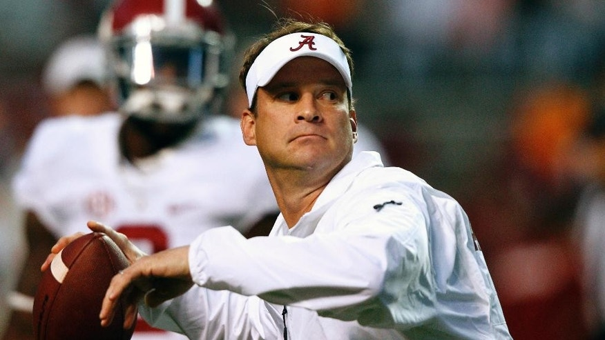 Alabama offensive coordinator Lane Kiffin throws during warmups before an NCAA college football game against Tennessee, Saturday, Oct. 25, 2014 in Knoxville, Tenn. (AP Photo/Wade Payne)