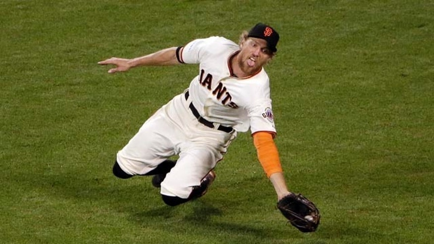 October 25, 2014: San Francisco Giants' Hunter Pence makes a diving catch for the out on a ball hit by Kansas City Royals' Lorenzo Cain during the ninth inning of Game 4 of baseball's World Series. (AP Photo/Marcio Jose Sanchez)