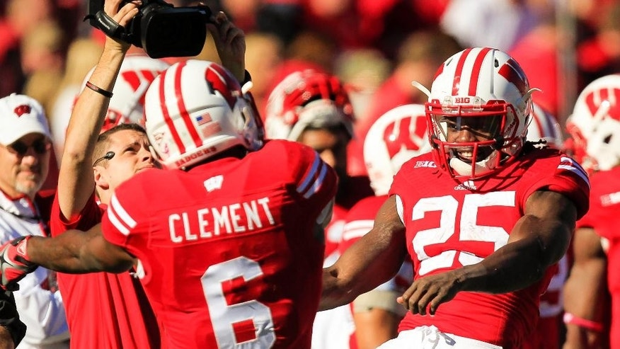 Wisconsin's Corey Clement (6) and Melvin Gordon (25) celebrate Clement's touchdown against Maryland during the second half of an NCAA college football game Saturday, Oct. 25, 2014, in Madison, Wis. Wisconsin won 52-7. (AP Photo/Andy Manis)