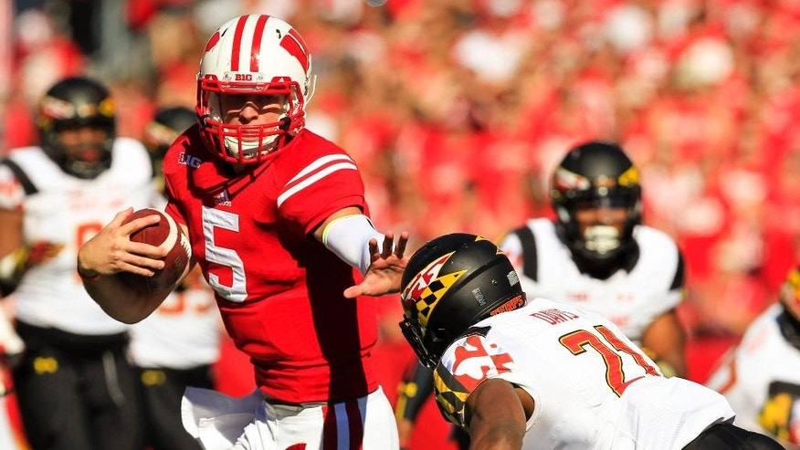Wisconsin quarterback Tanner McEvoy (5) runs against Maryland defensive back Sean Davis (21) on a 60-yard touchdown run during the second half of an NCAA college football game Saturday, Oct. 25, 2014, in Madison, Wis. Wisconsin won 52-7. (AP Photo/Andy Manis)