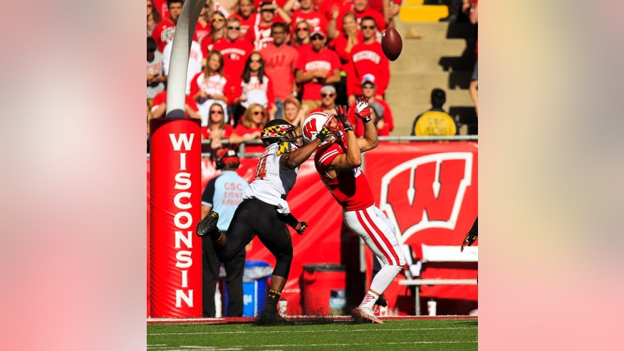 Wisconsin wide receiver Alex Erickson (86) makes a touchdown reception against Maryland defensive back Jeremiah Johnson (14) during the second half of an NCAA college football game Saturday, Oct. 25, 2014, in Madison, Wis. Wisconsin beat Maryland 52-7. (AP Photo/Andy Manis)