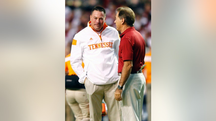 Tennessee coach Butch Jones, left, talks with Alabama head coach Nick Saban before an NCAA college football game Saturday, Oct. 25, 2014, in Knoxville, Tenn. (AP Photo/Wade Payne)