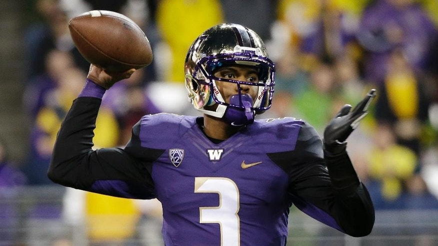 Washington quarterback Troy Williams drops back to pass against Arizona State during the first half of an NCAA college football game Saturday, Oct. 25, 2014, in Seattle. (AP Photo/Elaine Thompson)