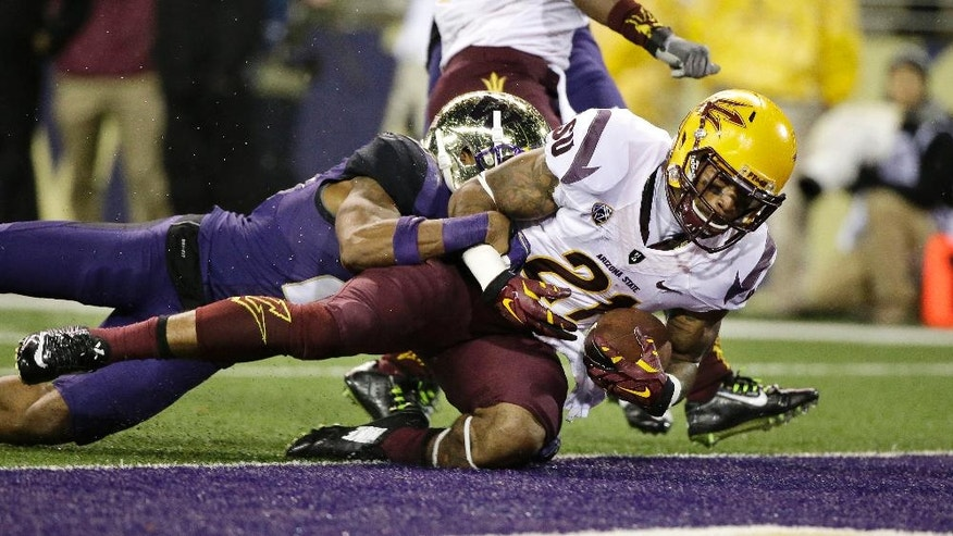 Arizona State's Jaelen Strong, right, scores in front of Washington's Marcus Peters during the first half of an NCAA college football game Saturday, Oct. 25, 2014, in Seattle. (AP Photo/Elaine Thompson)