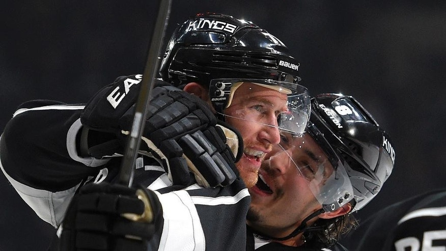 Los Angeles Kings left wing Dwight King, left, is congratulated by defenseman Drew Doughty after scoring during the second period of an NHL hockey game against the Columbus Blue Jackets, Sunday, Oct. 26, 2014, in Los Angeles. (AP Photo/Mark J. Terrill)